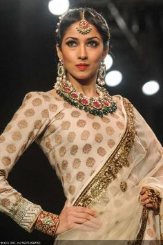 A model showcases a design by Golecha Jewels during the India International Jewellery Week (IIJW), held at Grand Hyatt, Mumbai, on August 06, 2013.