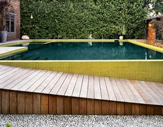 i like the green tiles around the pool. Photo by: David Allee