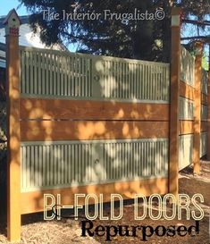 Old louvered bi-fold doors repurposed into a garden screen (with bird houses as post toppers!)