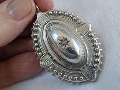 large antique victorian solid silver very ornate embossed raised gem set pendant
