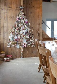 what a neat way to display all the ornaments throughout your life, I love this...
