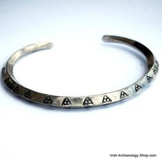 This Viking bracelet is based on a type of arm-ring known as ring-money. It's decorated with triangular motifs that are based on original Viking Age stamps