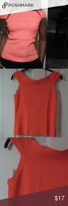 NWOT Cable & Gauge Top This bright coral top can be worn on or off the shoulders.  The fabric has a ribbed detail design and lots of stretch. T Viscose and nylon blend.The second picture is  more of the true color. Nice with black, white, jeans or any fun color. Offers welcome Cable & Gauge Tops