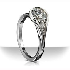 Platinum ring with tear drop motif accented with diamonds, Sholdt