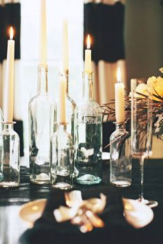Bottles as candle sticks.