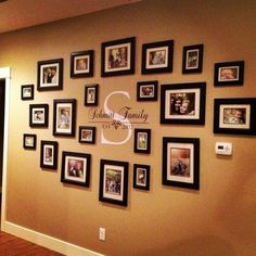 Family wall decor ideas family portraits centered around your monogram family picture wall decor ideas . Family Wall Decor, Family Room Decorating, Hallway Decorating, Decorating Ideas, Decor Ideas, Family Wall Collage, Apartment Wall Decorating, Picture Wall Collage, Family Picture Collages