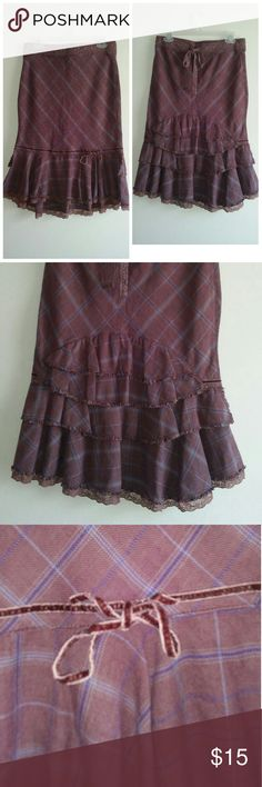 Free People Vintage skirt Tartan skirt with double lace layer look in the front. Back with cascading 4 layer gathering. Soft velvet bow in the front. Aline fit with flare at the bottom. Back hidden zipper. See photo 4 zips all the way down. See next photo refuses to go up 1 inch. When the lace bow is tied none noticeable. Price reduced. Fully unlined. Stretches. Colors burgundy, blue, tan. Free People Skirts