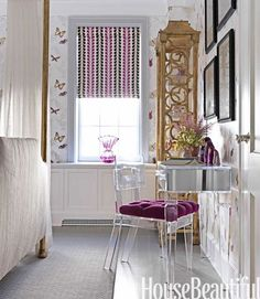 lucite, butterfly wallpaper, pops of purple, chinoiserie style shelf, mirror & lucite desk. Very sweet