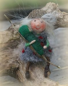 Acorn gnome with milkweed baby