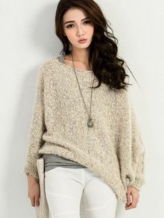 Giltter Fluffy Knit Top  This Giltter Fluffy Knit Top features a semi-fitted knitted top made up of wool and acrylic material. Boath neck. Long sleeves. Assymetrical hemline. Fashionably designed with Glittered Fluffy knit.