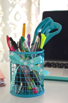 Makeover a Dollar Store treasure with a little paint and ribbon to make a cute DIY pencil cup that matches your personality and your desk.