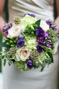 Elegant Bridal Bouquet Showcasing: Hydrangea, Roses, Lisianthus, Scabiosa Pods, Hypericum Berries, Stock, Ivy