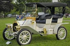 1909 Buick Model 10 Touring...brass and white...beautiful....