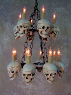 Think this could be miniature with chain necklace, mini skull beads, key rings & tooth pick candles......