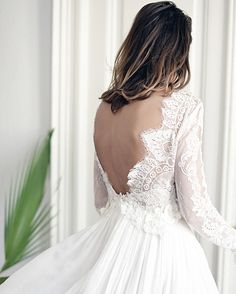 "My favorite capture of our ""Sól"" gown shoot.  Beautiful back details."