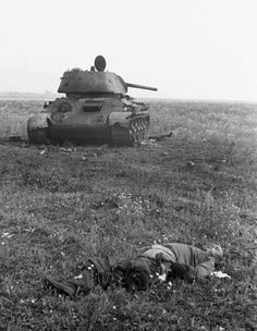 Russian KIA lies near knocked out T-34 tank, summer 1943. The Russians continued to absorb heavy casualties until the end of the war but, in contrast to the Germans, they had the reserves to cope.