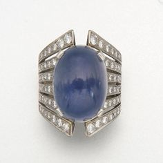 WHITE GOLD, STAR SAPPHIRE AND DIAMOND RING 1 sapphire and 64 diamonds approx 35.50 & 1.65 cts