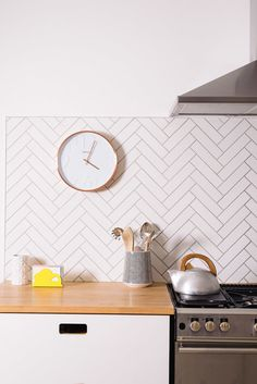 MissPrint utensil jar, copper wall clock, kitchen doors by Matt Antrobus, Picquot Ware kettle, white herringbone tiles Metro Tiles Kitchen, Kitchen Wall Tiles, Kitchen Doors, New Kitchen, Patterned Kitchen Tiles, Kitchen Backsplash, Herringbone Wall Tile, Kitchen Wall Clocks, Cuisines Design