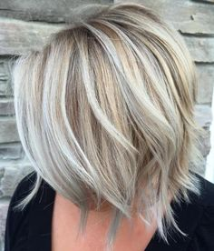 Layered Blonde Balayage ash blonde with piecy layers at the bottom