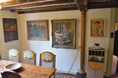 Monks House * The dining room * Portraits by Vanessa Bell of Leonard Woolf and Virginia
