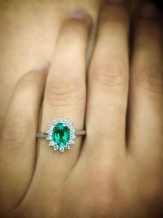 Beautiful green emerald Diana engagement ring is handcrafted from 14k white gold and is also available in 14k yellow or rose gold, set with a beautiful