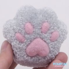 In this tutorial, I will be showing you how to make a fluffy kitty paw with pompom. I hope this tutorial. Pom Pom Crafts, Yarn Crafts, Diy And Crafts, Crafts For Kids, Pom Pom Animals, Crochet Socks Pattern, How To Make A Pom Pom, How To Make Toys, Wool Art
