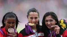 Gold medallist Asli Cakir Alptekin of Turkey poses on the podium day 15