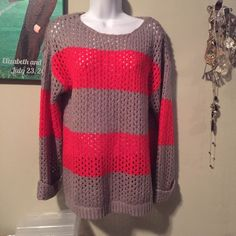 Grey and orange knit sweater with cuffed sleeves Perfectly paired with skinny jeans or leggings Sweaters