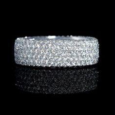Diamond eternity wedding ring featuring 343 pavé set round brilliants 3.41ctw set in 18k white gold.