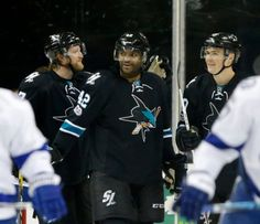 San Jose Sharks' Paul Martin (7), San Jose Sharks' Joel Ward (42) celebrate with San Jose Sharks' Ryan Carpenter (40), who scores goal against the Tampa Bay Lightning in the second period of their NHL game at SAP Center in San Jose, Calif., on Thursday, January 19, 2017. (Josie Lepe/Bay Area News Group)