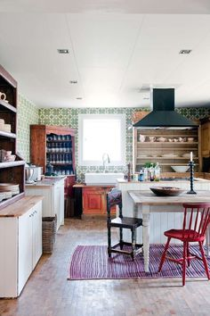 I like the beaded board and wood topped counters and island. and flooring