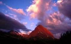 Preview wallpaper mountains, montana, clouds, sky, evening, national park