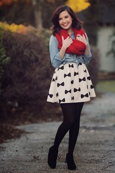 Chambrag shirt with red warm scarf and white, black skirt and black shoes