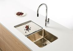 The Lago Undermount Double Bowl Sink and the Armando Vicario Gooseneck Mixer is a classic and stylish choice for the kitchen.