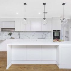 Looking for a kitchen splash back? Large format tiles can be a great option! Not only cost effective, they have zero maintenance and very few grout lines. These are marble look tiles in this modern shak Marbel Kitchen, Kitchen Splashback Tiles, White Marble Kitchen, Large Kitchen Tiles, Marble Look Tile, Shaker Style Kitchens, Modern Shaker Kitchen, Small Kitchens, Large Format Tile
