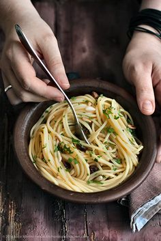 Garlic, oil, and chili spaghetti, a traditional Italian dish with a twist: pine nuts and passolina | Vegan recipe