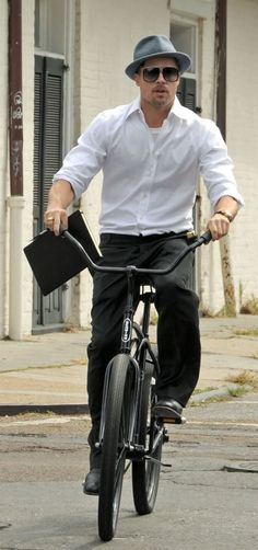 Brad Pitt riding a bicycle