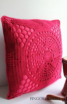 rasberry pink crochet covered cushion