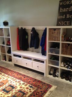 two IKEA Expedit bookcases ($69) and an IKEA Hemnes TV Stand ($169) in the center. I love this! Perfect for the playroom too! or kids room too, put the bench under a window! for the office window, maybe? | Casual Crafter