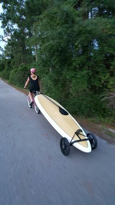 Bike + Paddle board = Easy transportation  With SUP Wheels! Could possibly modify for kayak/canoe