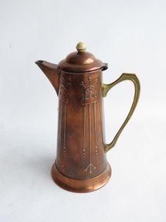 An Art Nouveau copper jug, brass handle, Bakelite finial Copper Utensils, Copper Metal, Brass Handles, Urn, My Favorite Color, Teapot, Antique Silver, Art Nouveau, Antiques