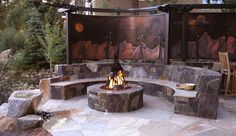 Squaw Valley Ski resort private residence.  Wrought iron and copper trellis, water feature, outdoor kitchen and fire ring with sculpture.