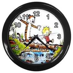 """Personalized Calvin & Hobbes Room Wall Clock  Here is the perfect keepsake gift to give to a friend, relative or even yourself. Personalization is included in this item. The fonts and colors can be changed as well.  - Details The custom wall clock is perfect for a home, business, shop, or for a gift. - It measures 10"""" in diameter. - Plastic frame with a plastic face cover. - Requires 1 AA battery (not included)."""