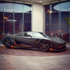 Koenigsegg Agera RS made out of exposed carbon fiber w/ orange accents Photo taken by: @sevencarlounge on Instagram (@hussein_musallam on Instagram is the owner of the car)