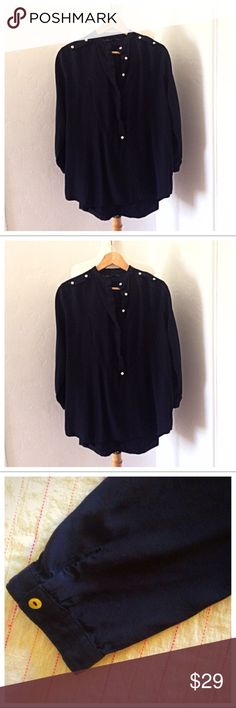 Street Style Zara Button Down L/S Black Blouse Very nice black Zara collarless shirt. Buttons down to mid stomach so can be worn Tunic style or tucked in. Button detail on shoulders. Hidden buttons can be worn v neck plunge style. In excellent preowned condition. No flaws. Machine washable. Size XL. Measures 21 inches flat across bust. 30 inches from collar to hem. Material is medium weight, not sheer. I cut the material tag off but this is like a heavier weight matte silk polyester blend…