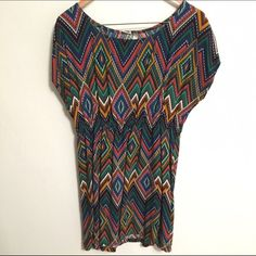African Print Tunic Cute African style printed tunic (could be a dress for a more petite person!). Purchased at a local boutique - brand is Pauln KC. Super cute with a belt and black leggings or jeans! Boutique Tops Tunics