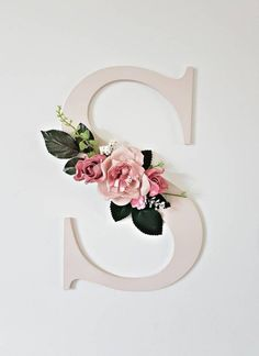 Gorgeous floral wall initials. Make the perfect statement piece for your home or nursery. Available in 4 sizes (30cm is pictured) Painted in soft pink (other colours are available) and decorated with a stunning selection of artificial flowers and foliage. If you would it painted another colour just
