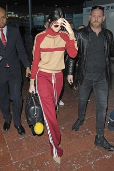 The Trend: Sporty Luxe - Kendall Jenner pulls off one of the season's hottest trends—the coordinated track suit—with aplomb. The separates are slim-fit yet slightly forgiving, which is key to appearing polished (too baggy or tight can read sloppy). Sleek accessories further elevate her athleisure look.