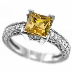 This ring is set with a lovely high quality princess-cut orange citrine. The gem is accented with dazzling white diamonds. The ring is available in 14k white, yellow, and rose gold.