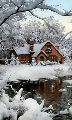 cabin in the snow - it looks like a life size gingerbread house!